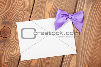 Greeting card with purple bow