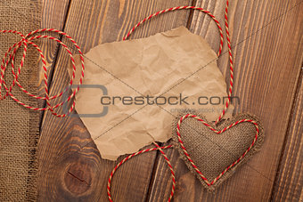 Blank old piece of paper and vintage handmaded valentines day heart