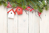 Christmas wooden background with fir tree and birdhouse decor
