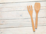 Kitchen utensil over wooden table
