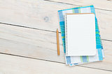 Notepad over kitchen towel on wooden table