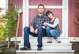Mixed Race Couple Relaxing on the Steps