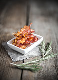 Fried bacon strips with fresh rosemary