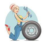 Beautiful girl mechanic with wheel