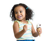 Kid eating ice cream isolated and looking aside