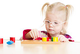 Kid in eyeglases playing logical game isolated