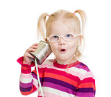 Funny child in eyeglasses using a can as a telephone isolated