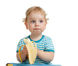 Kid boy eating banana isolated