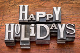 Happy Holidays in metal type