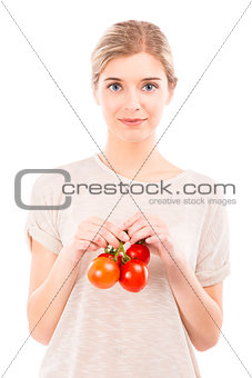Beaitiful woman holding red tomatos