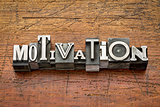 motivation word in metal type