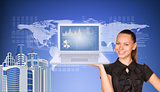 Beautiful businesswoman in dress smiling and holding latop with graphs. Buildings, world map, text rows