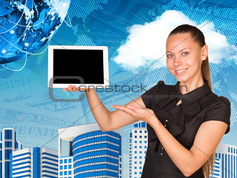 Beautiful businesswoman holding hand tablet with blank screen. Buildings, money and Earth as backdrop
