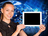 Beautiful businesswoman holding tablet pc with blank screen. Earth, network and calculator as backdrop