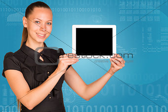 Beautiful businesswoman in dress holding tablet pc. Graphs and figures as backdrop