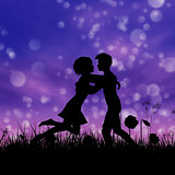 Couple silhouette on grass field