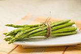 Bunch of fresh asparagus tie