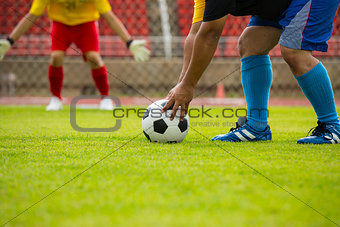Attack soccer player shooting to defense team