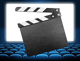 cinema clapper board on movie screen blue audience