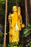 Golden standing Buddha statue