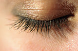 Close-up of closed eye with long eyelashes macro