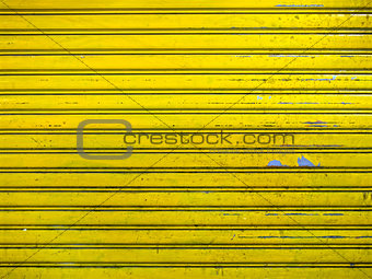 grunge bright yellow roller shutter door texture background