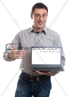 portrait of confident young man advertising laptop