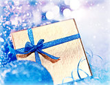 Golden blue Christmas gift with baubles decorations