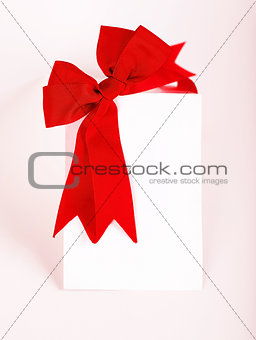 Beautiful red bow over blank card
