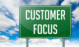 Customer Focus on Highway Signpost.