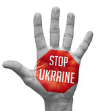 Stop Ukraine Sign Painted, Open Hand Raised.