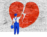 Symbol of broken love painted over brick wall by man