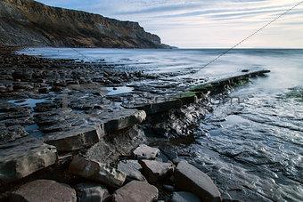 Beautiful seascape landscape of rocky shore at sunset