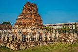 chedi surrounded lion statues Wat Thammikarat temple Ayutthaya b