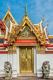 golden door dragon statues Wat Pho temple bangkok Thailand