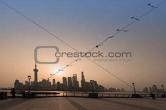 man kiting on the bund waterfront Shanghai China