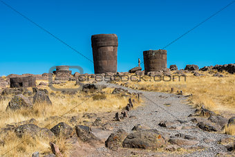 Tourist Silustani tombs in the peruvian Andes at Puno Peru