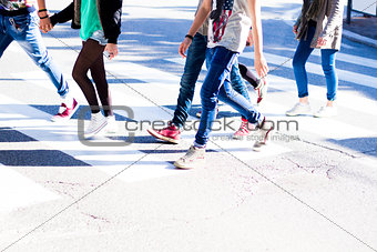 boys crossing the pedestrian crossing