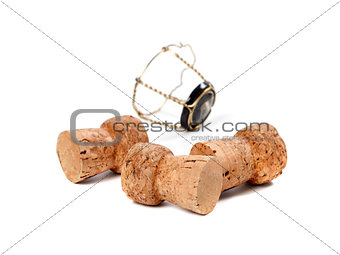 Three corks from champagne wine and muselet isolated on white ba