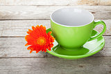 Coffee cup and gerbera flower