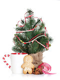 Christmas mulled wine with fir tree, gingerbread and decor