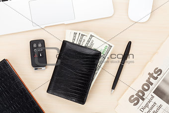 Office table with pc, supplies, newspaper and money cash