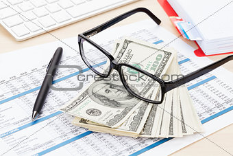 Office table with pc, supplies and money cash