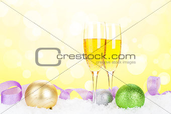 Champagne and christmas decor with snow