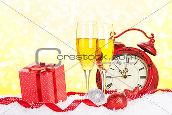 Champagne, gift box and christmas clock