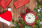 Christmas wooden background with clock, fir tree, gift boxes