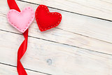 Valentines day background with toy hearts and ribbon