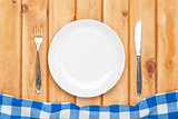 Empty plate, silverware and towel