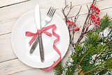 Silverware on plate and christmas tree decor