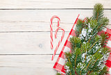 Christmas background with candy cane and snow fir tree